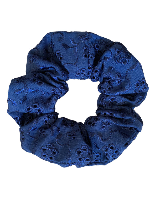 Scrunchies are back and they're here to stay! These stunning scrunchies look great in your hair and also work as gorgeous accessories.  Colour/Pattern: Navy broderie anglaise Material: Cotton Polyester blend  Washing instructions: Cold hand wash  Dimensions: Material width approximately 4 cm  Made by us in Bondi Beach  With love from Larzy xx