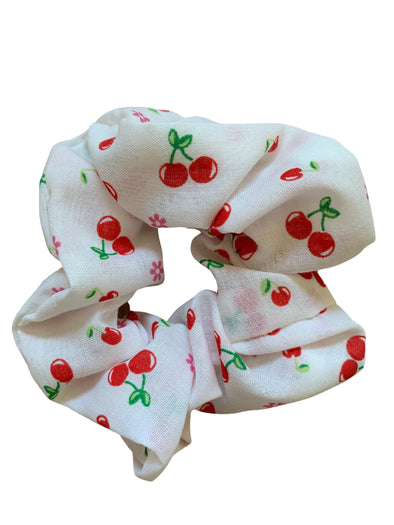 Scrunchies are back and they're here to stay! These stunning scrunchies look great in your hair and also work as gorgeous accessories.  Colour/Pattern: White with cherries  Material: Cotton Poly Poplin blend Washing instructions: Cold hand wash  Dimensions: Material width approximately 4 cm  Made by us in Bondi Beach  With love from Larzy xx
