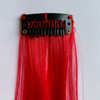 Clip in red hair extensions
