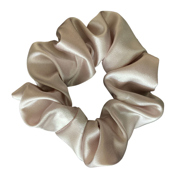 Scrunchies are back and they're here to stay! These stunning scrunchies look great in your hair and also work as gorgeous accessories.  Colour/Pattern: Champagne Material: Satin  Washing instructions: Cold hand wash  Dimensions: Material width approximately 5 cm  Made by us in Bondi Beach  With love from Larzy xx