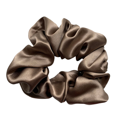 Scrunchies are back and they're here to stay! These stunning scrunchies look great in your hair and also work as gorgeous accessories.  Colour/Pattern: Light Brown Material: 100% Mulberry Silk  Washing instructions: Cold hand wash  Dimensions: Material width approximately 4 cm  Made by us in Bondi Beach  With love from Larzy xx