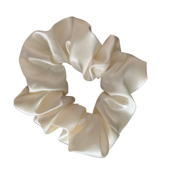 Scrunchies are back and they're here to stay! These stunning scrunchies look great in your hair and also work as gorgeous accessories.  Colour/Pattern: Cream  Material: Satin  Washing instructions: Cold hand wash  Dimensions: Material width approximately 5 cm  Made by us in Bondi Beach  With love from Larzy xx