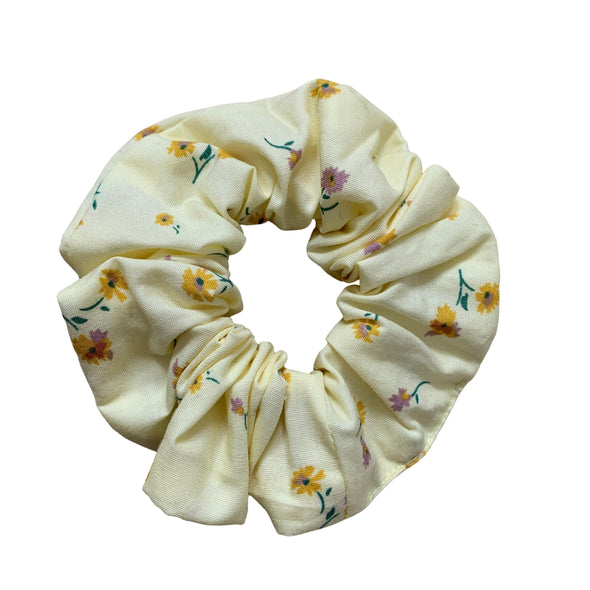 Scrunchies are back and they're here to stay! These stunning scrunchies look great in your hair and also work as gorgeous accessories.  Colour/Pattern: Yellow with yellow and pink flowers Material: 100% Cotton  Washing instructions: Cold hand wash  Dimensions: Material width approximately 4 cm  Made by us in Bondi Beach  With love from Larzy xx