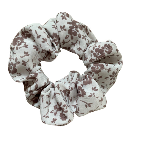 Scrunchies are back and they're here to stay! These stunning scrunchies look great in your hair and also work as gorgeous accessories.  Colour/Pattern: White with brown flowers Material: 100% Cotton Washing instructions: Cold hand wash  Dimensions: Material width approximately 4 cm  Made by us in Bondi Beach  With love from Larzy xx
