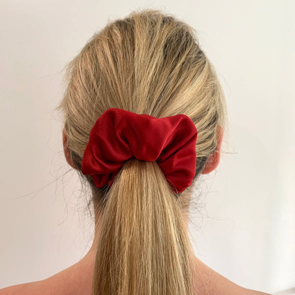 Scrunchies are back and they're here to stay! These stunning scrunchies look great in your hair and also work as gorgeous accessories.  Colour/Pattern: Red Material: Satin (medium weight)  Washing instructions: Cold hand wash  Dimensions: Material width approximately 4 cm  Made by us in Bondi Beach  With love from Larzy xx