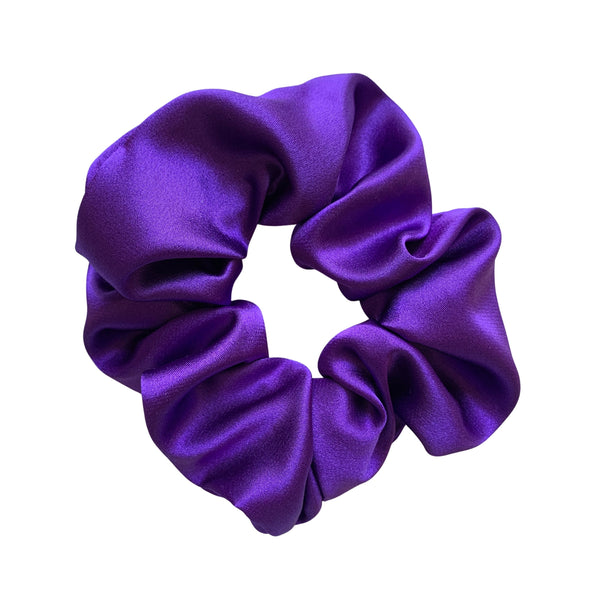 Scrunchies are back and they're here to stay! These stunning scrunchies look great in your hair and also work as gorgeous accessories.  Colour/Pattern: Purple Material: Satin Washing instructions: Cold hand wash  Dimensions: Material width approximately 4 cm  Made by us in Bondi Beach  With love from Larzy xx
