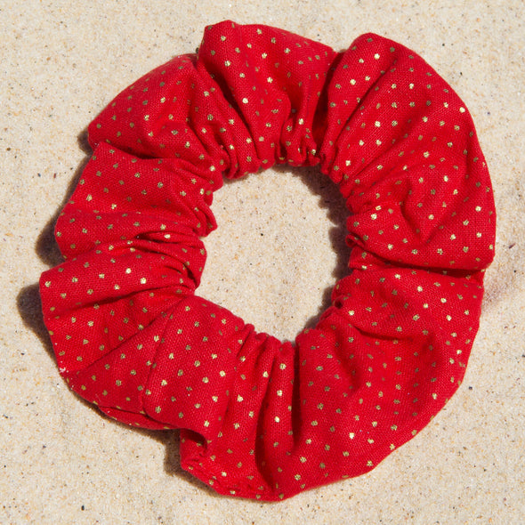red scrunchie with small gold spots