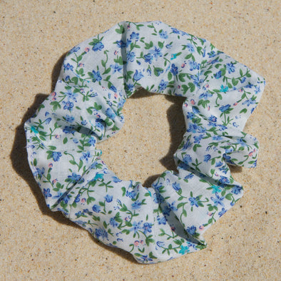 white scrunchie with blue flowers