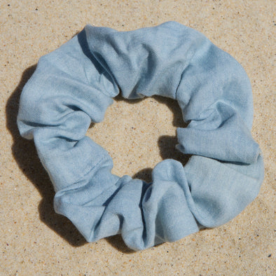 Scrunchies are back and they're here to stay! These stunning scrunchies look great in your hair and also work as gorgeous accessories.  Colour/Pattern: Light blue denim Material: Cotton Washing instructions: Cold hand wash  Dimensions: Material width approximately 4 cm  Made by us in Bondi Beach  With love from Larzy xx