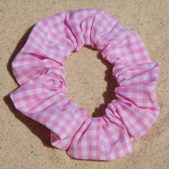 Scrunchies are back and they're here to stay! These stunning scrunchies look great in your hair and also work as gorgeous accessories.  Colour/Pattern: Pink and white gingham  Material: Cotton  Washing instructions: Cold hand wash  Dimensions: Material width approximately 4 cm  Made by us in Bondi Beach  With love from Larzy xx