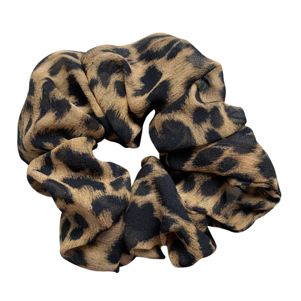 Scrunchies are back and they're here to stay! These stunning scrunchies look great in your hair and also work as gorgeous accessories.  Colour/Pattern: Leopard  Material: 100% Mulberry Silk Washing instructions: Cold hand wash  Dimensions: Material width approximately 4 cm  Made by us in Bondi Beach  With love from Larzy xx