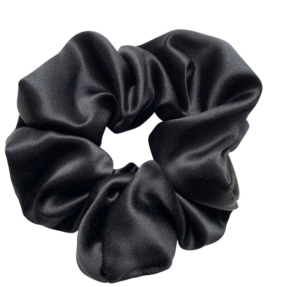 Scrunchies are back and they're here to stay! These stunning scrunchies look great in your hair and also work as gorgeous accessories.  Colour/Pattern: Black Material: 100% Mulberry Silk  Washing instructions: Cold hand wash  Dimensions: Material width approximately 4 cm  Made by us in Bondi Beach  With love from Larzy xx