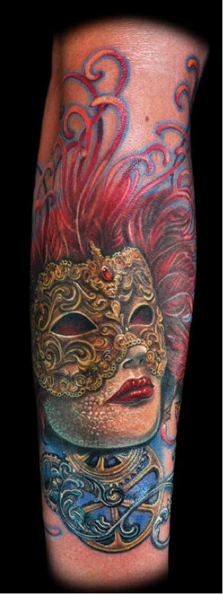 Heavily Detailed And Featuring A Bold Red Hue This Stunning Tattoo Not Only Features Venetian Mask But It Also Depicts The Person Wearing