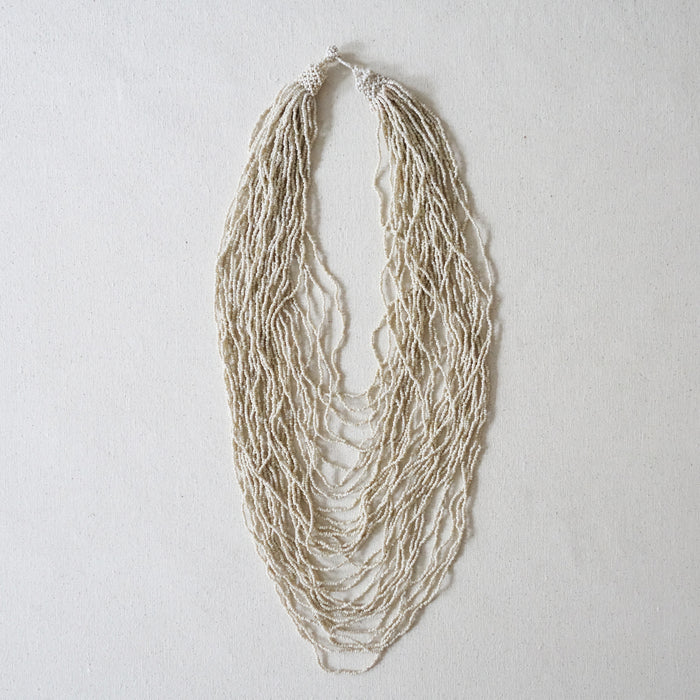 White multi strand beaded necklace