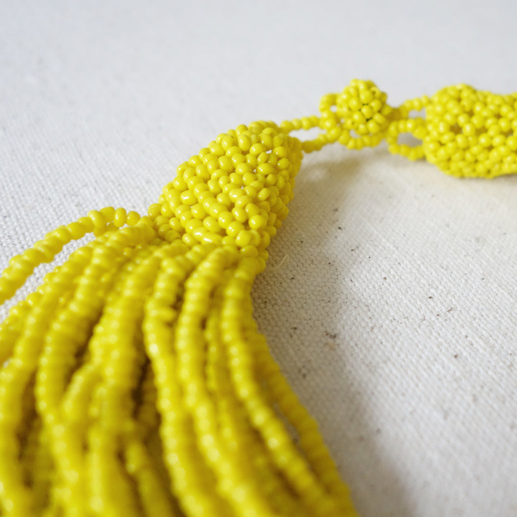 Yellow multi strand beaded necklace