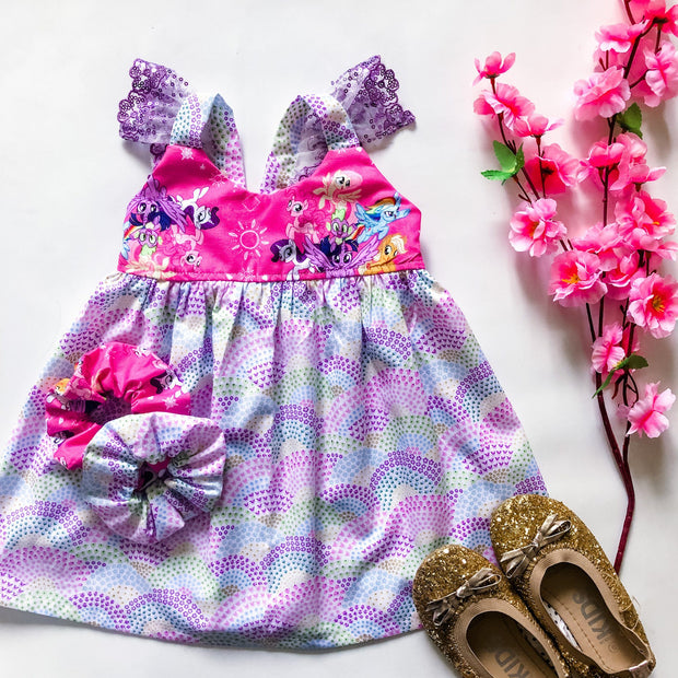 Hummingbird Dress - Stella - Mini Mooches is an Australian owned business specialising in handmade clothing and accessories for girls aged between 1-10. Beautifully designed Floral Dresses, Peplum Tops, Suspender skirts and shorts. Special occasions to everyday wear.