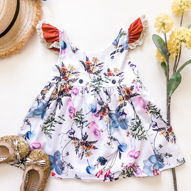Bay Dress - Cherry - Mini Mooches is an Australian owned business specialising in handmade clothing and accessories for girls aged between 1-10. Beautifully designed Floral Dresses, Peplum Tops, Suspender skirts and shorts. Special occasions to everyday wear.