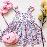Isabelle Easter Tea Dress - Mini Mooches is an Australian owned business specialising in handmade clothing and accessories for girls aged between 1-10. Beautifully designed Floral Dresses, Peplum Tops, Suspender skirts and shorts. Special occasions to everyday wear.