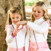 Skivvy - Vanilla Cream - Mini Mooches is an Australian owned business specialising in handmade clothing and accessories for girls aged between 1-10. Beautifully designed Floral Dresses, Peplum Tops, Suspender skirts and shorts. Special occasions to everyday wear.