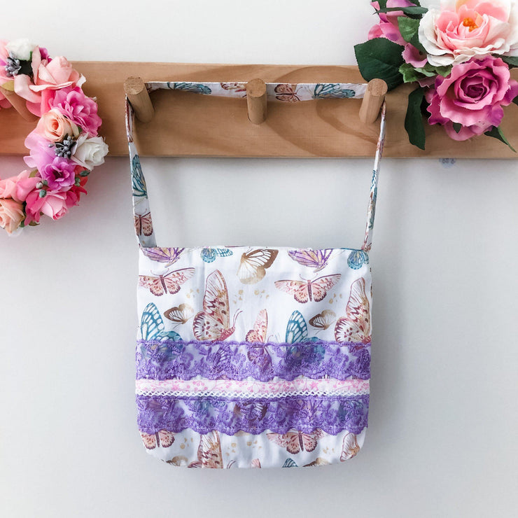 Mini Handbag - Butterflies - Mini Mooches is an Australian owned business specialising in handmade clothing and accessories for girls aged between 1-10. Beautifully designed Floral Dresses, Peplum Tops, Suspender skirts and shorts. Special occasions to everyday wear.