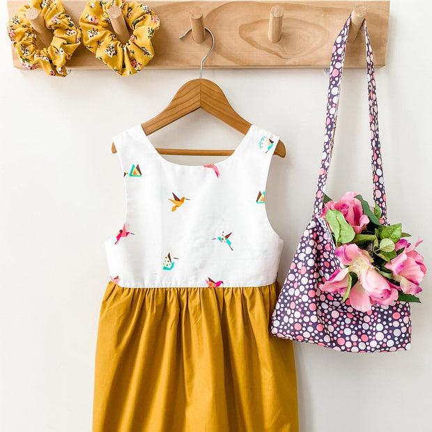 Tea Dress - Tori (Re-Release) - Mini Mooches is an Australian owned business specialising in handmade clothing and accessories for girls aged between 1-10. Beautifully designed Floral Dresses, Peplum Tops, Suspender skirts and shorts. Special occasions to everyday wear.