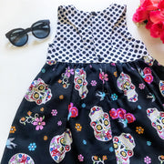 Morticia Skulls Tea Dress - Mini Mooches is an Australian owned business specialising in handmade clothing and accessories for girls aged between 1-10. Beautifully designed Floral Dresses, Peplum Tops, Suspender skirts and shorts. Special occasions to everyday wear.
