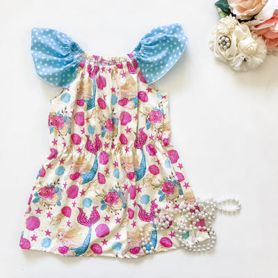 Callie Ruby Dress - Mini Mooches is an Australian owned business specialising in handmade clothing and accessories for girls aged between 1-10. Beautifully designed Floral Dresses, Peplum Tops, Suspender skirts and shorts. Special occasions to everyday wear.