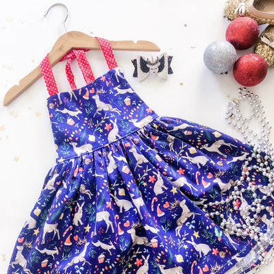 Mary Jive Dress Christmas - Mini Mooches is an Australian owned business specialising in handmade clothing and accessories for girls aged between 1-10. Beautifully designed Floral Dresses, Peplum Tops, Suspender skirts and shorts. Special occasions to everyday wear.
