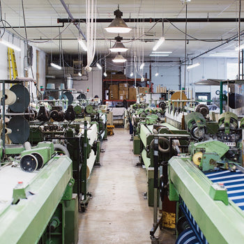 Maine Woolens currently has eight power looms, which the team uses to produce roughly 35,000 blankets per year. / Photo by Jesika Theos, Boston Magazine