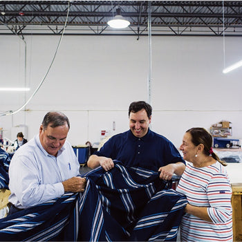 Boshold examines a blanket with her husband, Ray (left), and son, John. / Photo by Jesika Theos, Boston Magazine