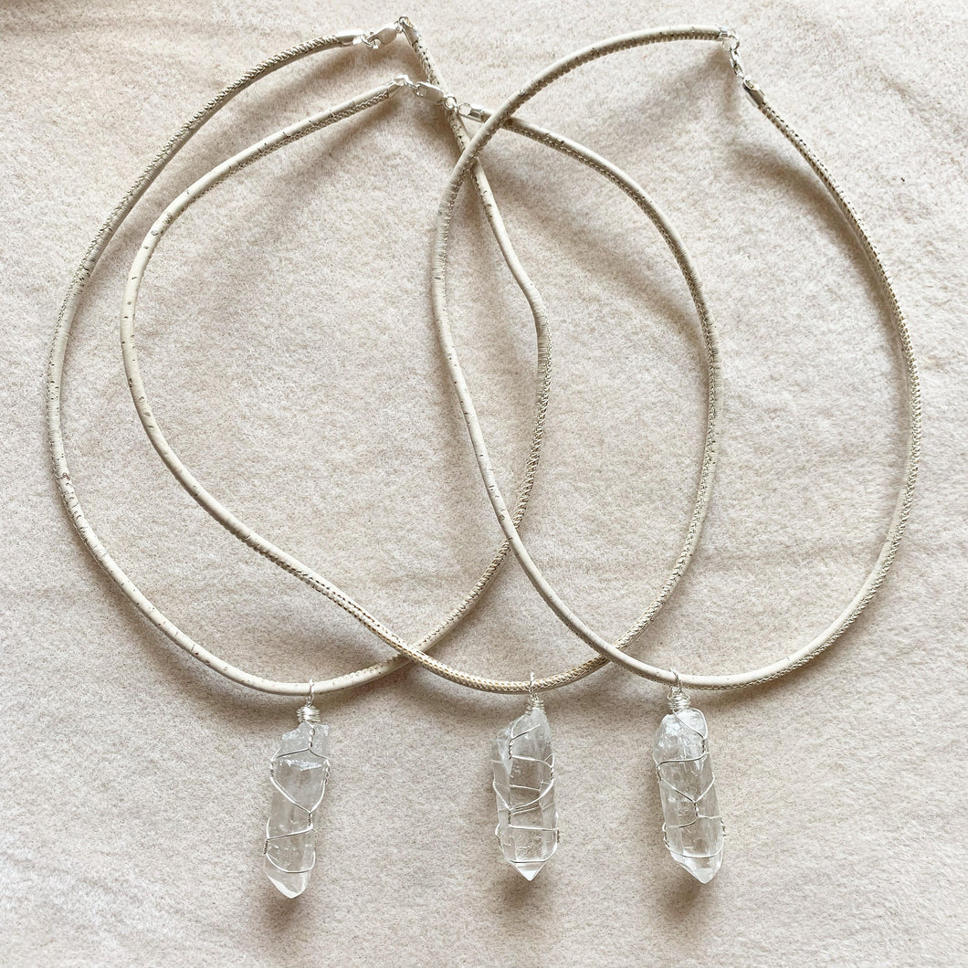 Clear quartz and faux leather pendant