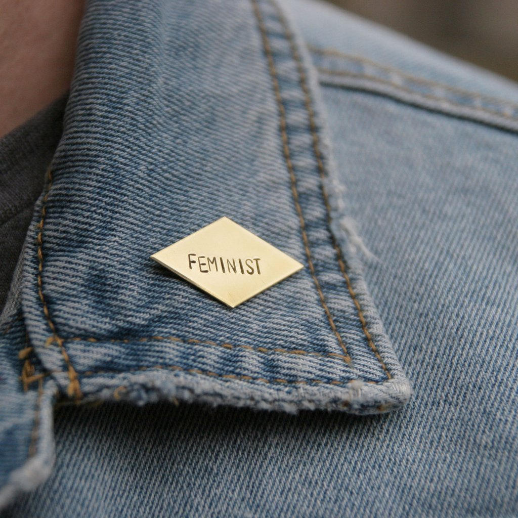 'feminist' stamped brass pin