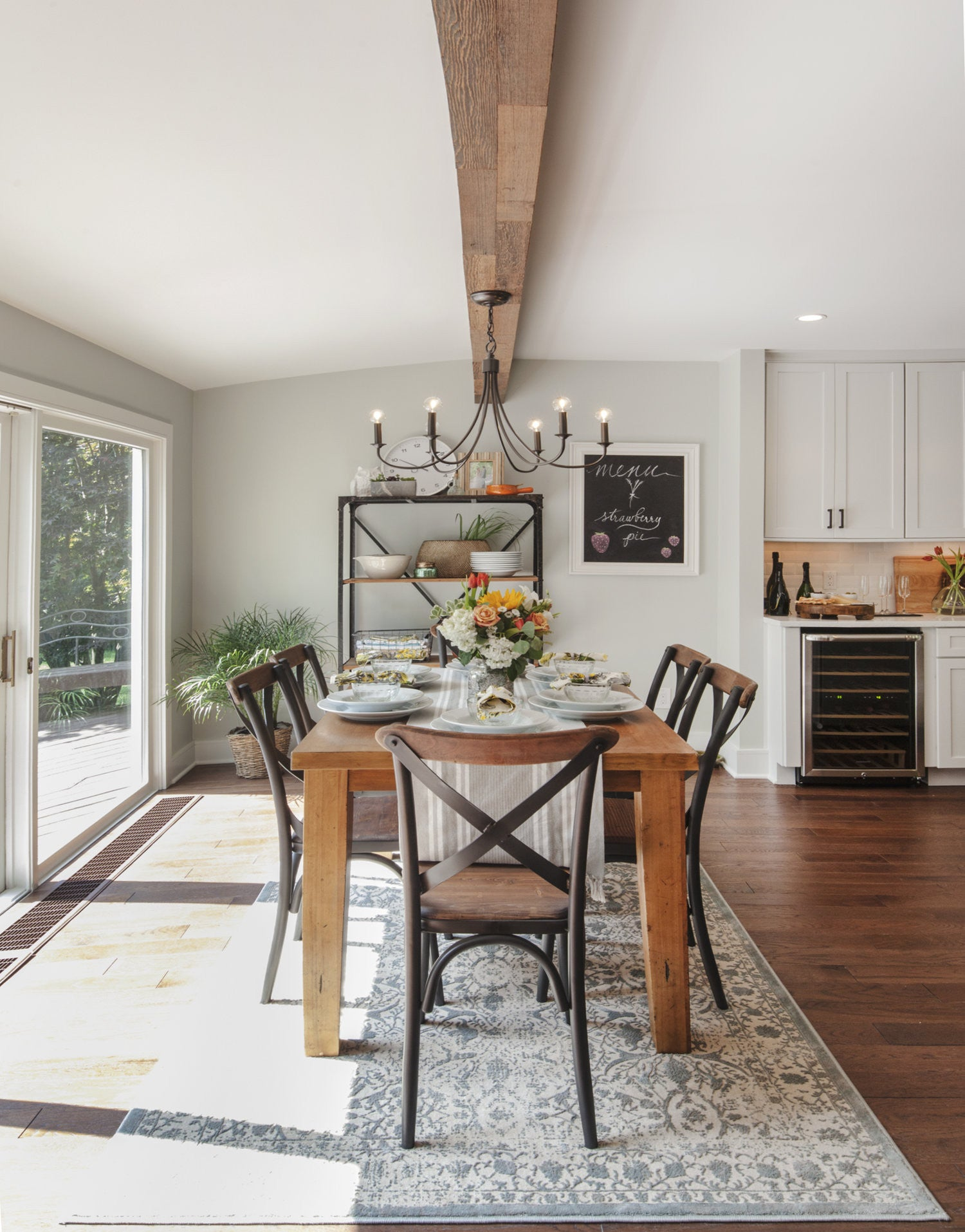 The Large Slider Door And Windows Ensure Theres No Shortage Of Light In This Bright Dining Room Setting Rather Than Settling With Plain White Beams