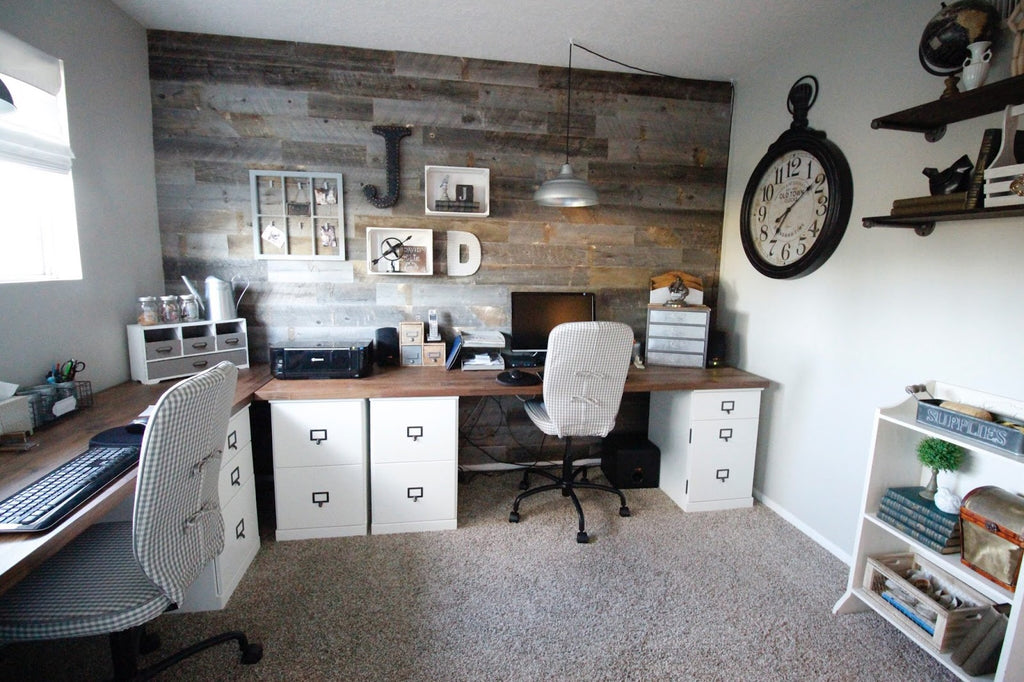 A Home Office With Custom Desks That Use Filing Cabinets And Are Set  Against A Modern