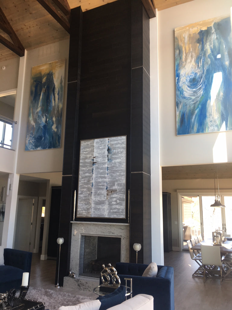 This Stikwood in Charcoal creates an elegant wood wall design around this fireplace. It's a truly impactful wood wall material.