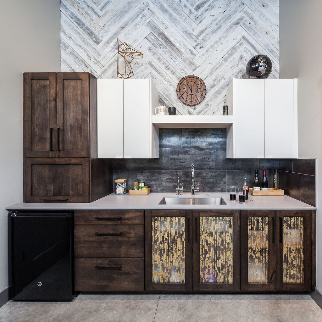 Wood Interior Wall Paneling in a Herringbone Pattern adds character above a wet bar.