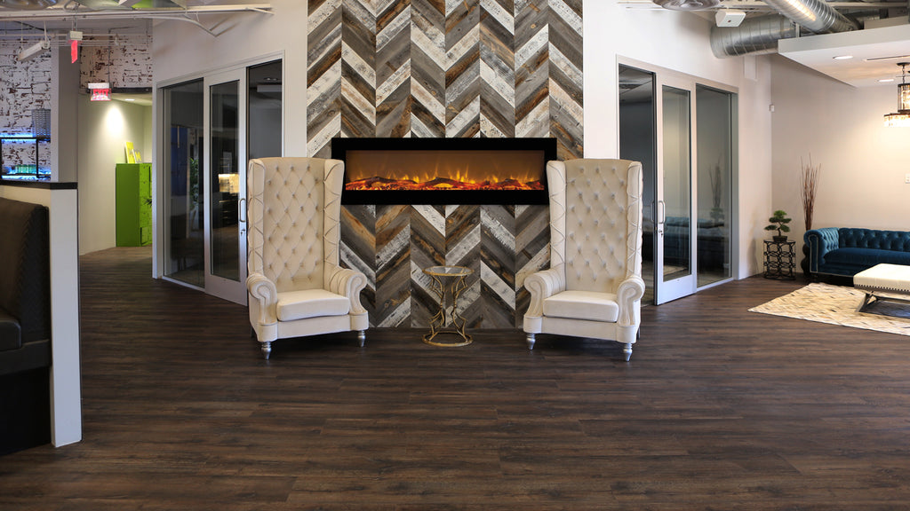 Stikwood interior wall paneling in a chevron pattern around a modern fireplace.