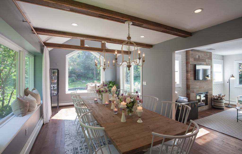 This dining room brings the outdoors in with panoramic windows and Reclaimed Sierra Gold Stikwood cladded tresses.