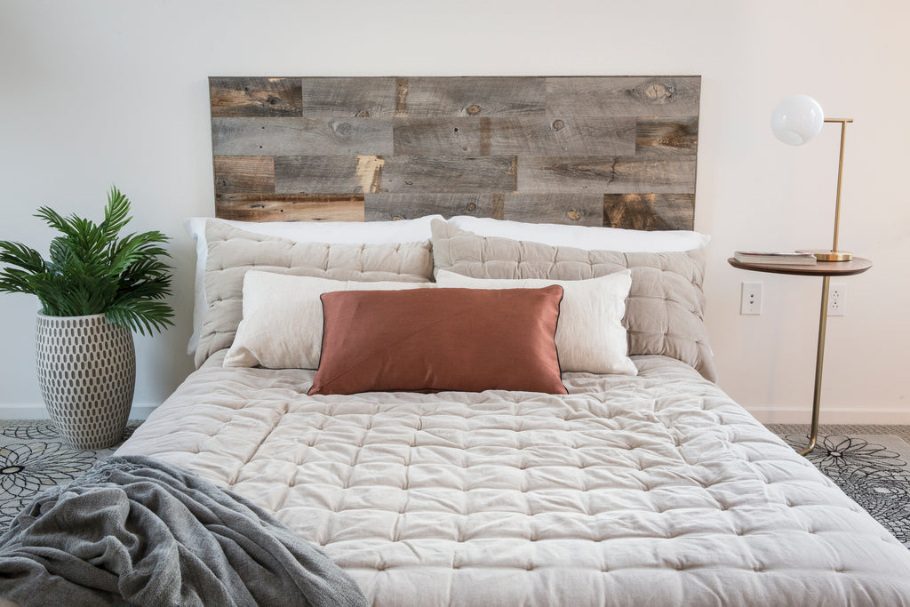 These rustic wooden headboards make the perfect backdrop for some simple cream bed linens.