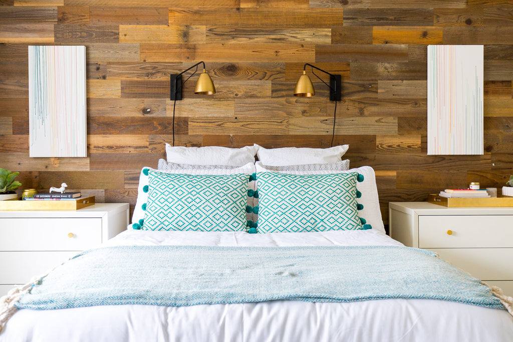 Rustic wooden headboards add warmth to a modern, clean master bedroom.