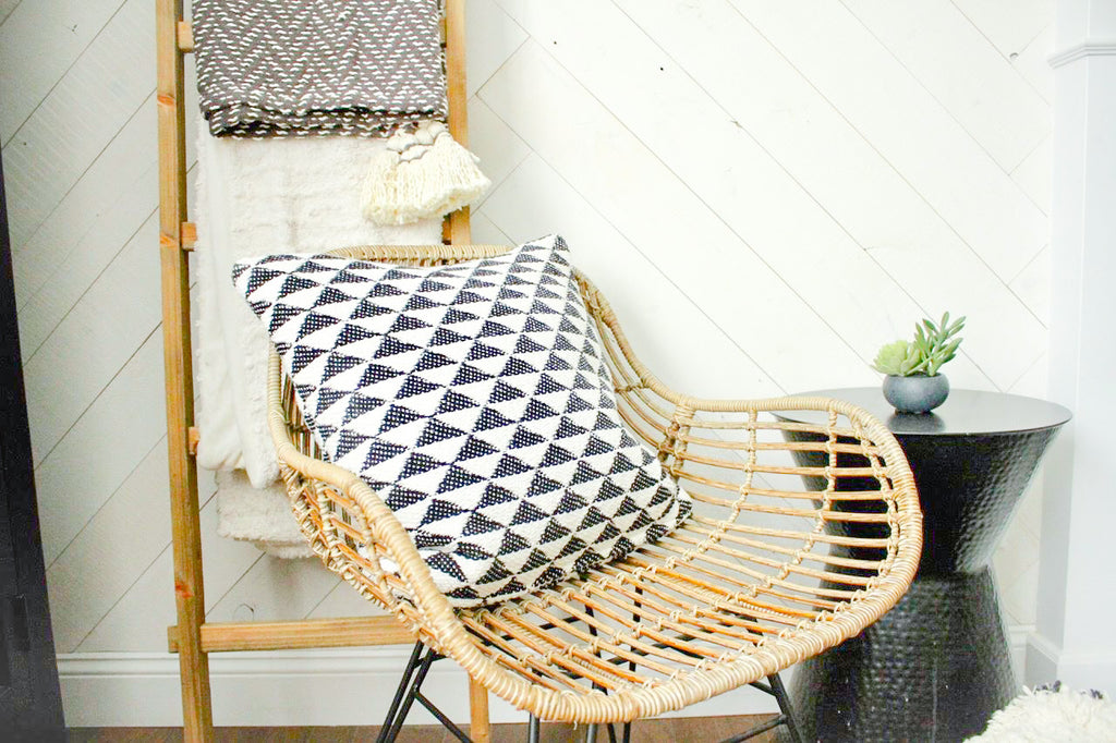 This bamboo rattan chair and blanket ladder really enhance the <a href=