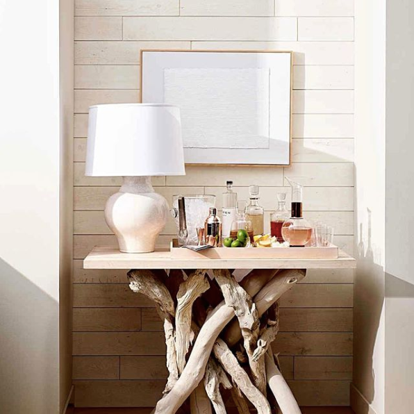 This driftwood console table is perfect in front of this Hamptons reclaimed wood wall.