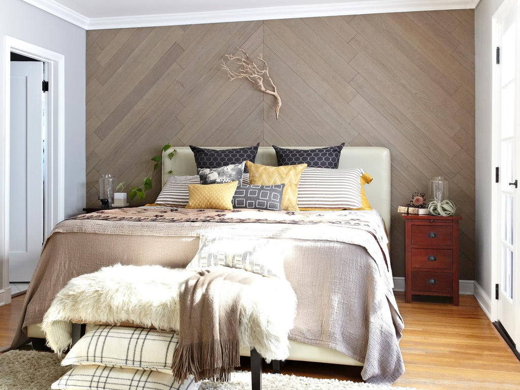 Soft Sand wood interior walls in a chevron pattern adorn this master bedroom.