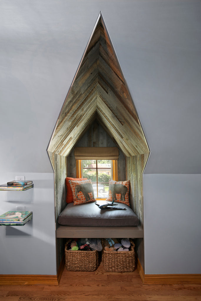 Reclaimed weathered wood Stikwood was used in this small reading nook that is pointed like a cathedral