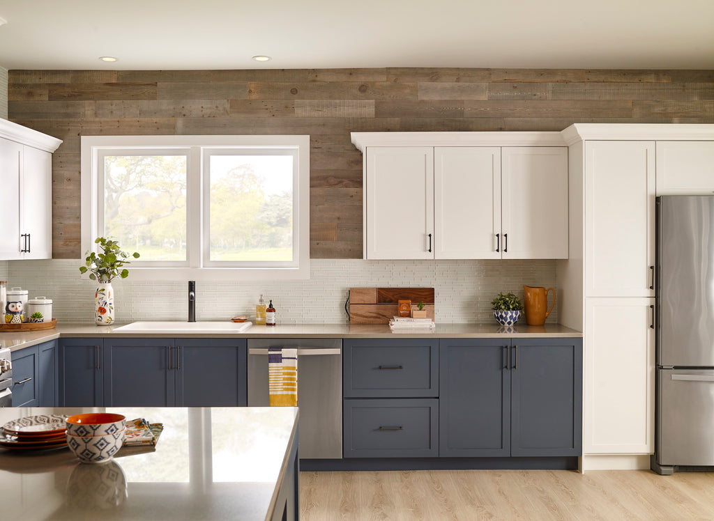 Barn wood wall paneling inspired reclaimed wood decorates the top of a contemporary blue and white kitchen.