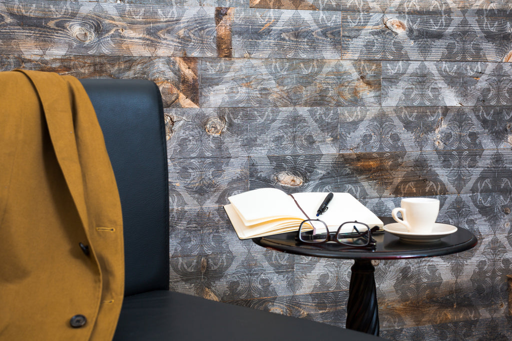 Reclaimed wood wall paneling adds a sophisticated touch to this study.