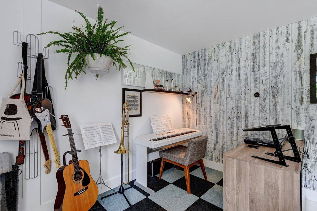 A rustic white peel and stick wood accent wall in a home music room.