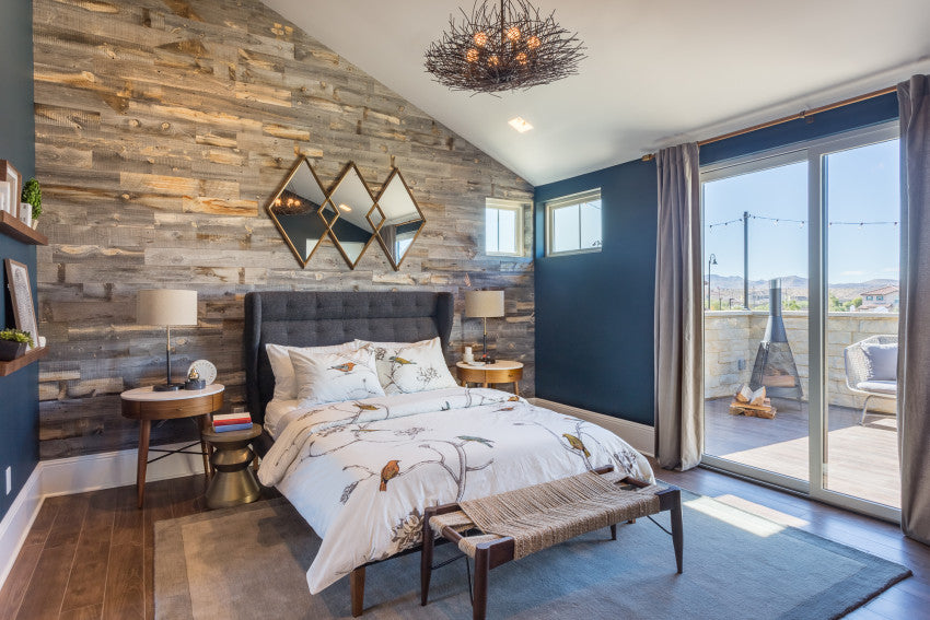 Reclaimed Weathered Wood adds warmth in a way that only reclaimed wood can in this turquoise bedroom.