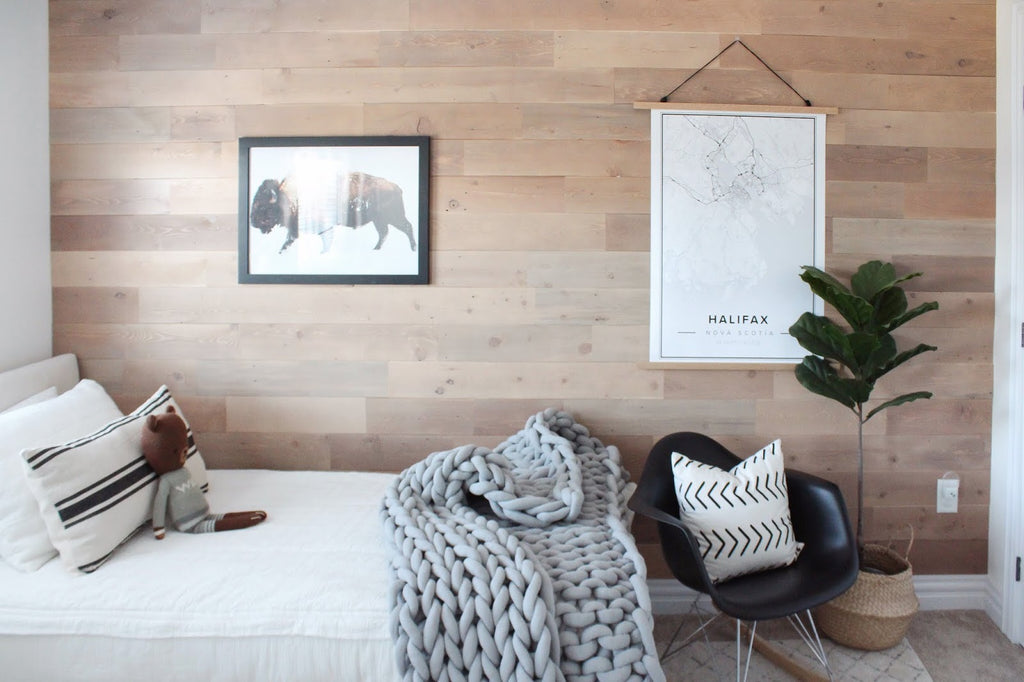 Modern boy bedroom design with buffalo picture hanging on rustic wood wall accent
