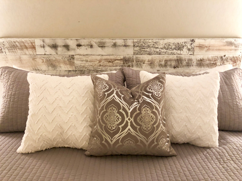 This Stikits headboard brings some rustic charm to a bedroom with it's reclaimed weathered wood planks in white.